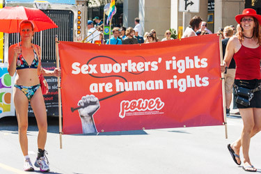 Women carrying a banner about sex workers' rights in the Capital Pride Parade on August 26, 2012 in Ottawa, Ontario. (David P. Lewis / Shutterstock.com)
