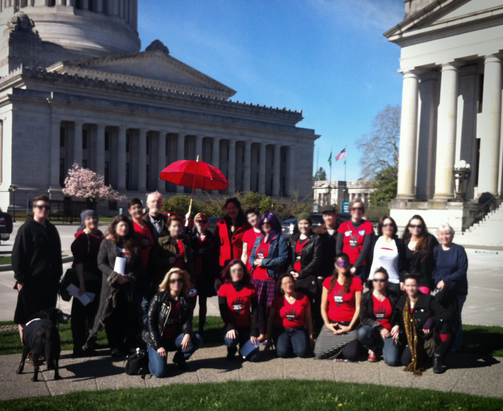 """Volunteers from SWOP-Seattle meet at the State House to express concerns over """"End Demand"""" bills."""